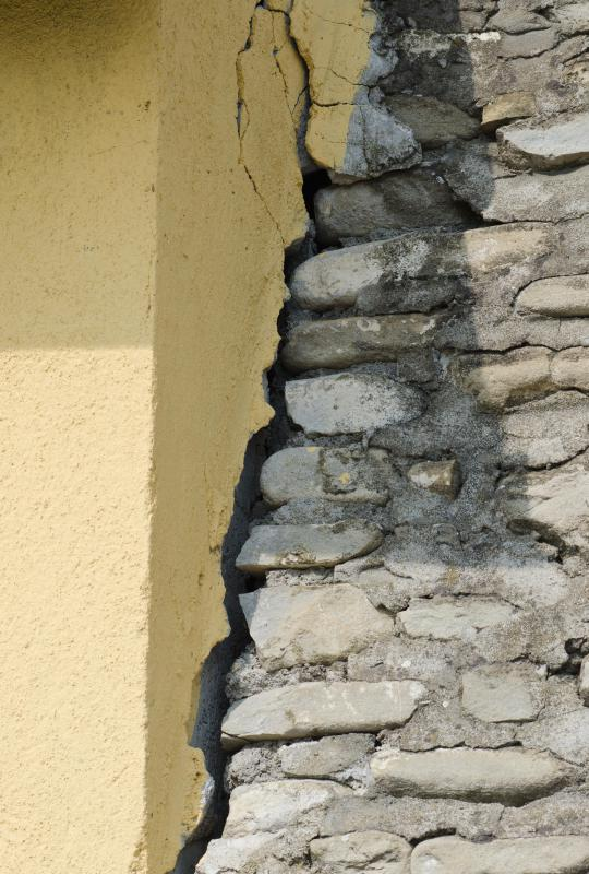 Deep, vertical cracks in exterior walls may indicate serious structural damage.