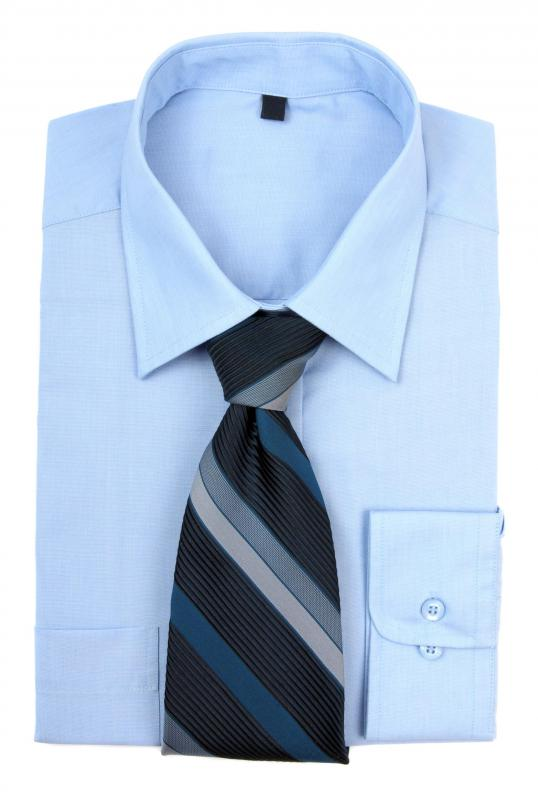 A dress shirt and tie are appropriate office attire for men at many companies.