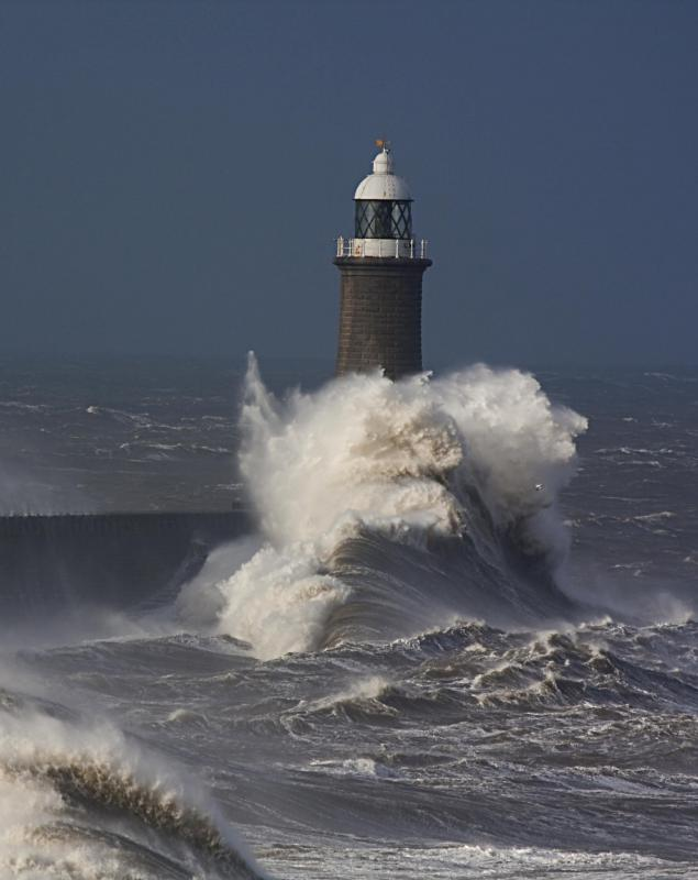 LIghthouse with stormy seas.