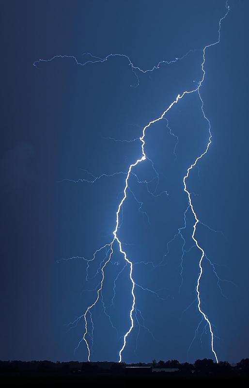 Lightning, which can cause a surge.