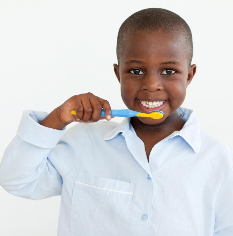 It may be best to select a toothbrush with a small, soft brush head and a larger handle to make it easier to hold.