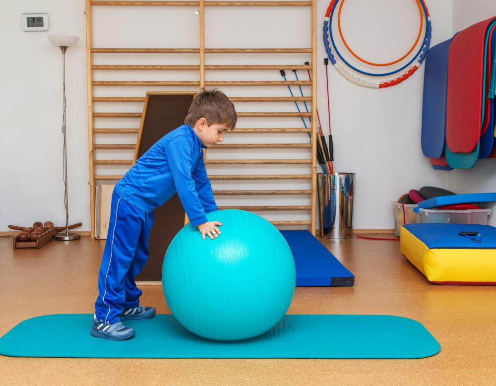 Occupational therapy is often used to help young children with developmental disabilities or delays to improve their ability to move their bodies so they can use scissors, ride tricycles and catch balls.