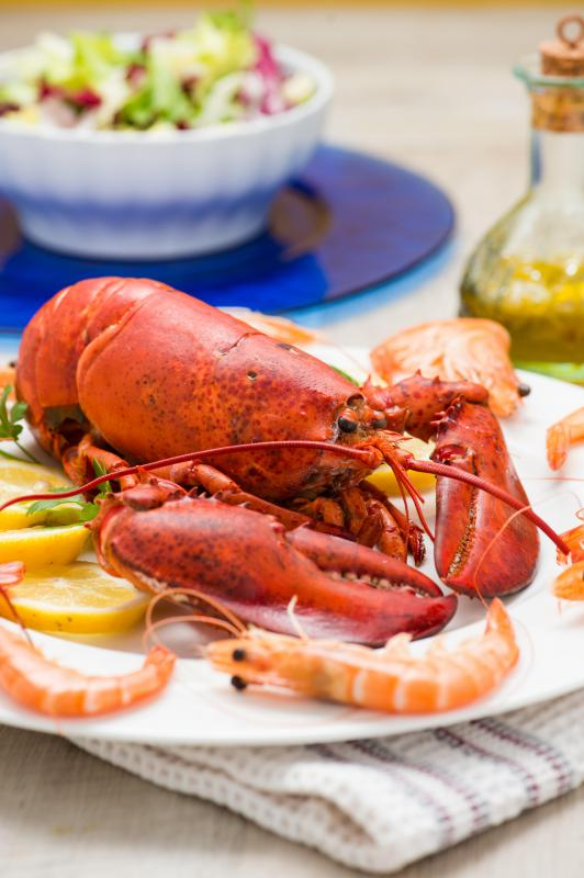 Steamed lobster and prawns are low-fat, high-protein entrees, provided the chef doesn't drench them in melted butter.