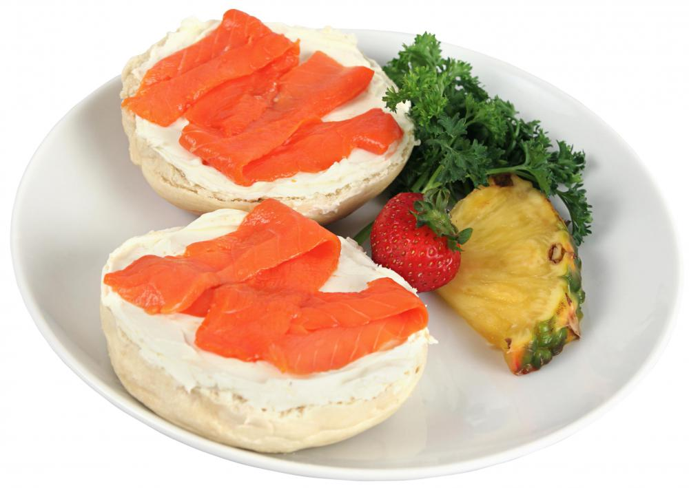 Lox, a form of smoked salmon, may be served with bagels and cream cheese.