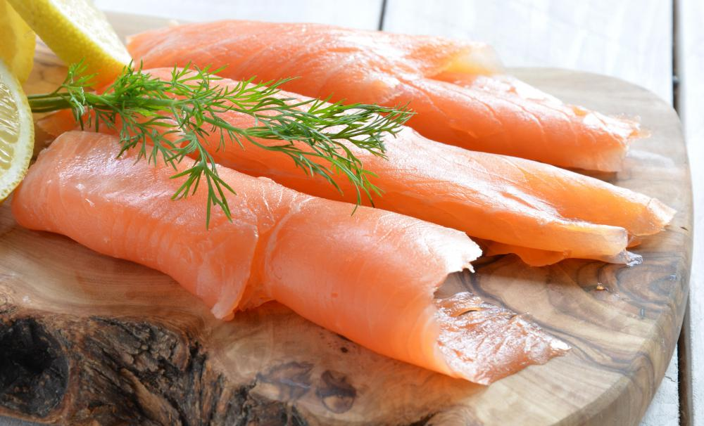 Lox is a thin filet of cured, cold smoked salmon that is often served with bagels.