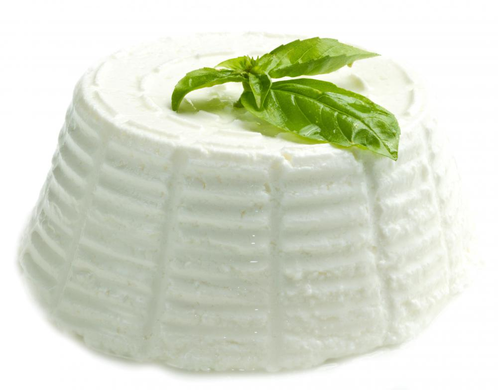 Goat cheese topped with basil.