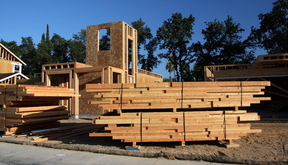 Components of a prefab house are manufactured in an off-site industrial  facility.