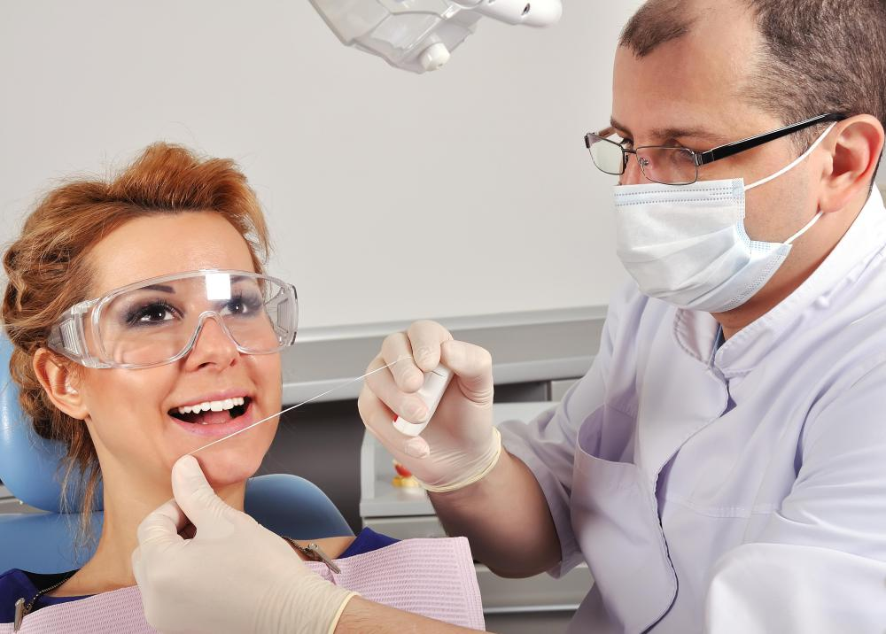 A dentist should be seen for a periodontal abscess.