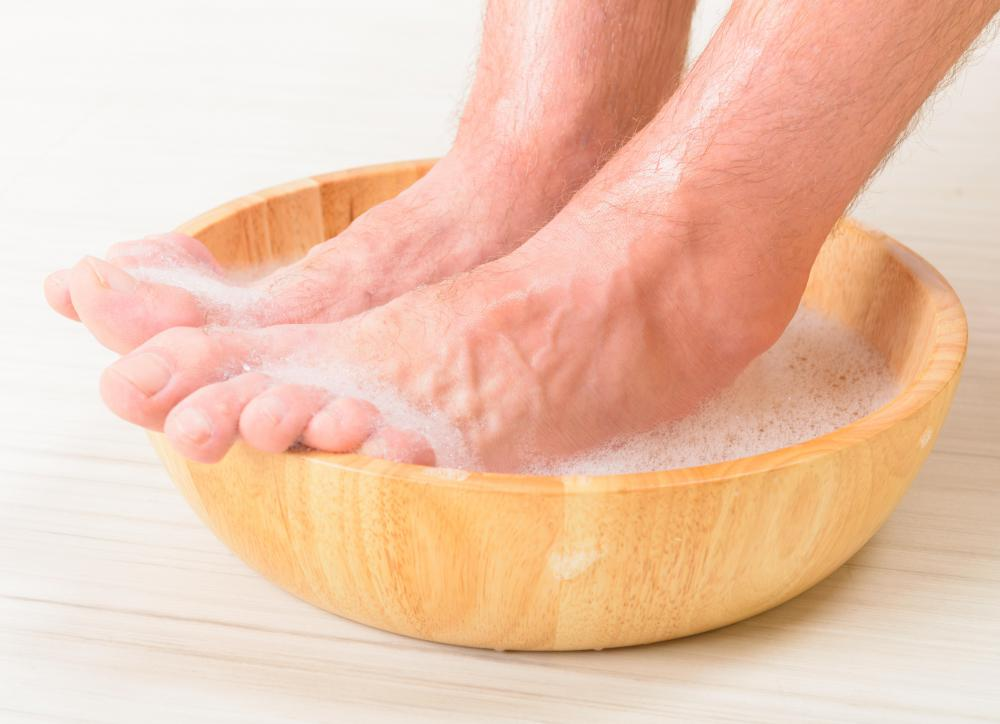 The feet will be placed in a small basin with warm water during the cleansing portion of a mini pedicure.