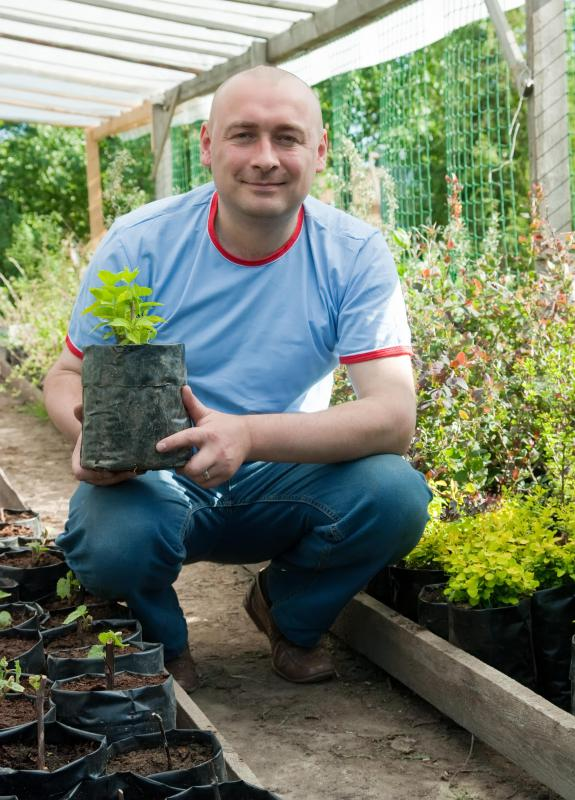 A nurseryman grows and sells plants.