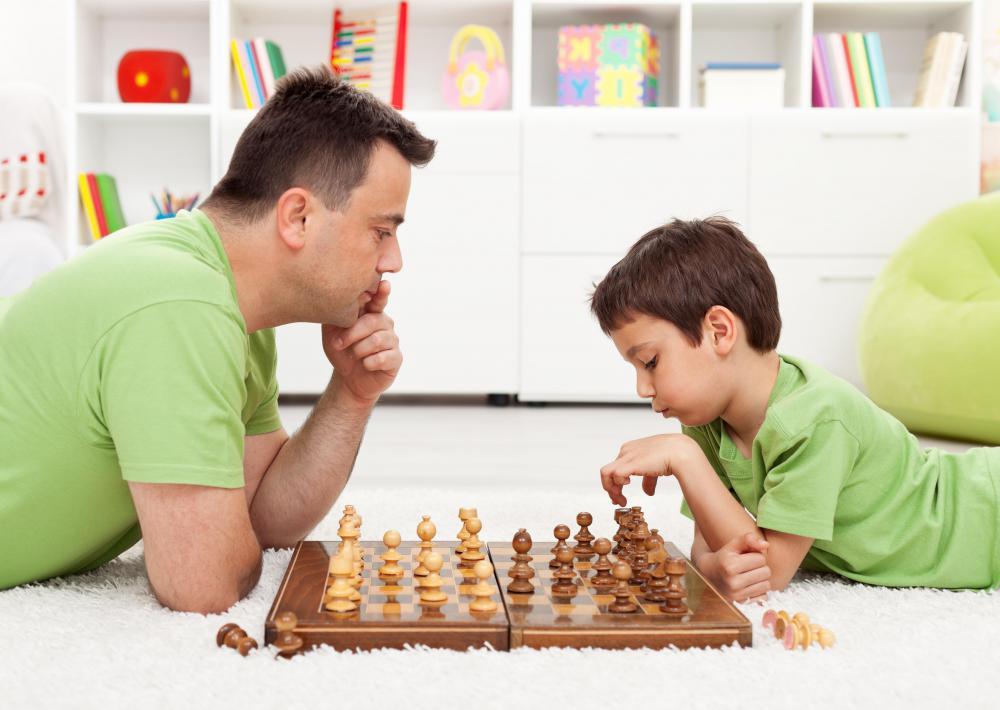 Showing a child how to play chess can encourage the development of analytical thinking.