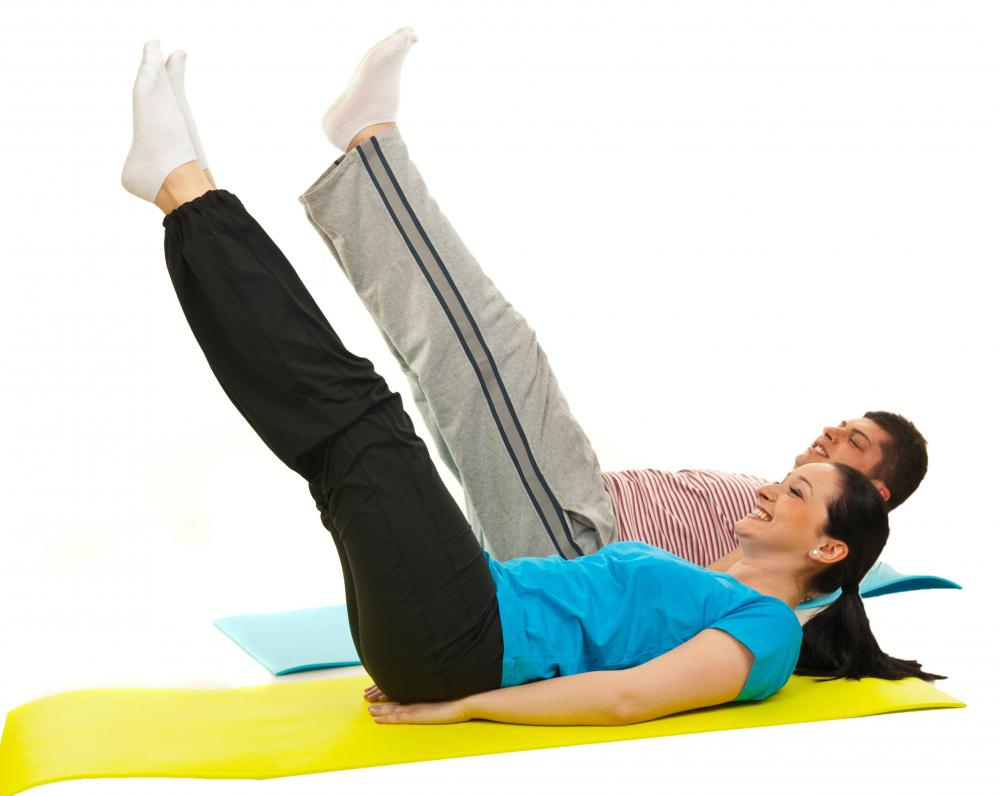 Abdominal exercises like leg raises are great for achieving a toned abdominal section.