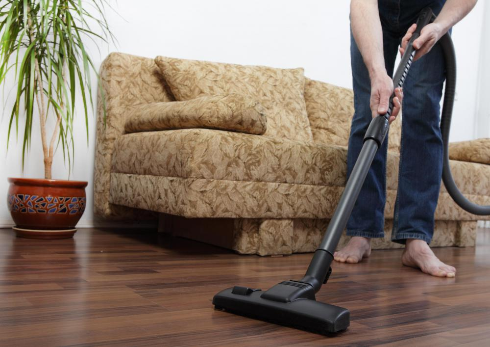 A man using a vacuum cleaner.