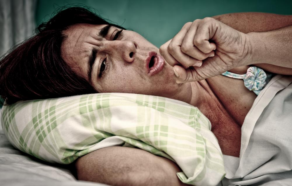 Symptoms of tuberculosis may include fatigue and coughing.