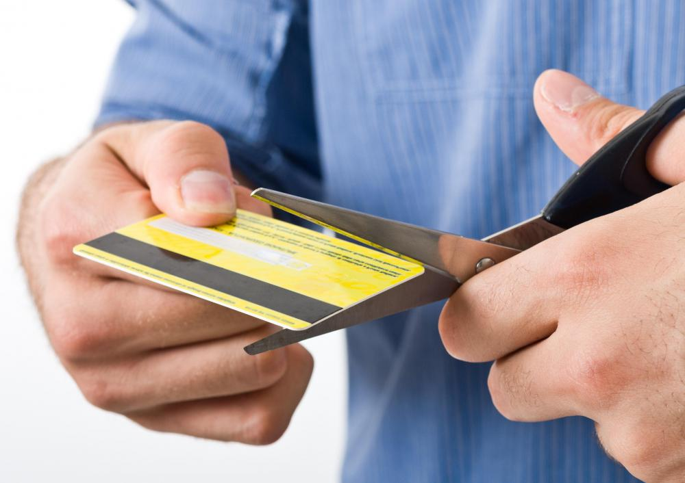 Cutting up credit cards can result in a decided reduction in credit card spending.