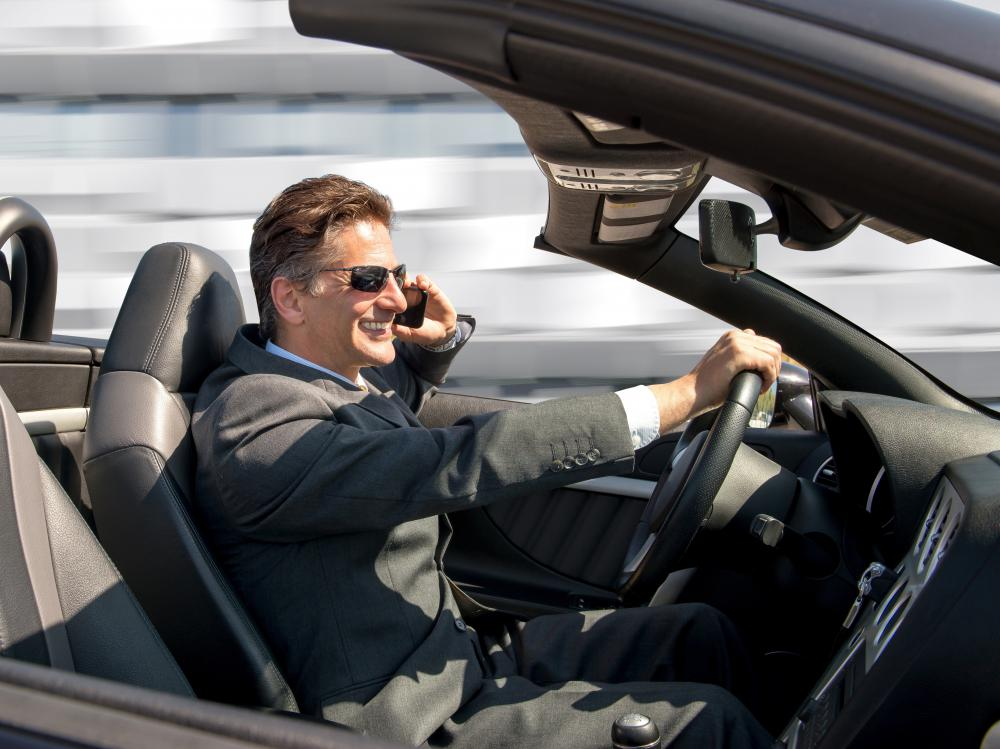 During driving, a cell phone speakerphone is a safer alternative to holding a phone with one hand pressed to the ear.