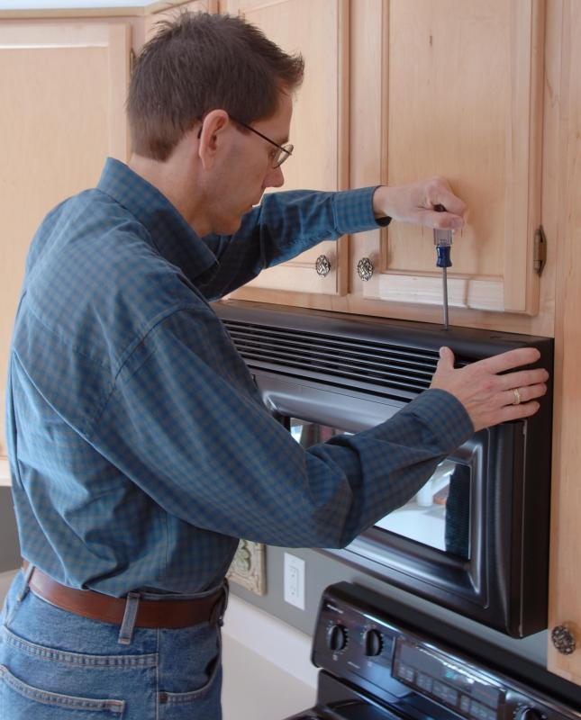 A microwave above the stove is preferred for fitted kitchens, as it saves counter space.