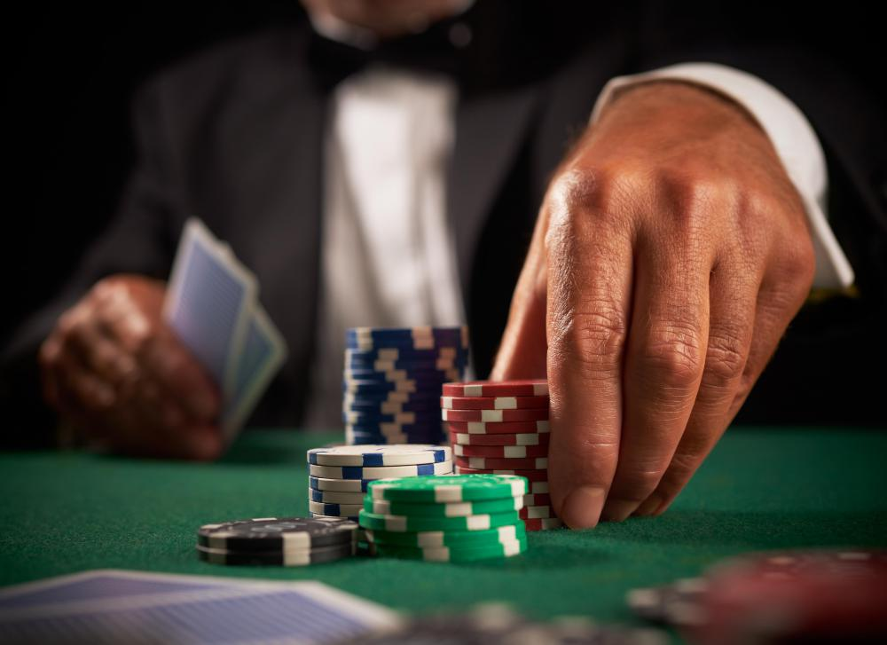 Signs of compulsive gambling can include risking large sums of money at casinos.