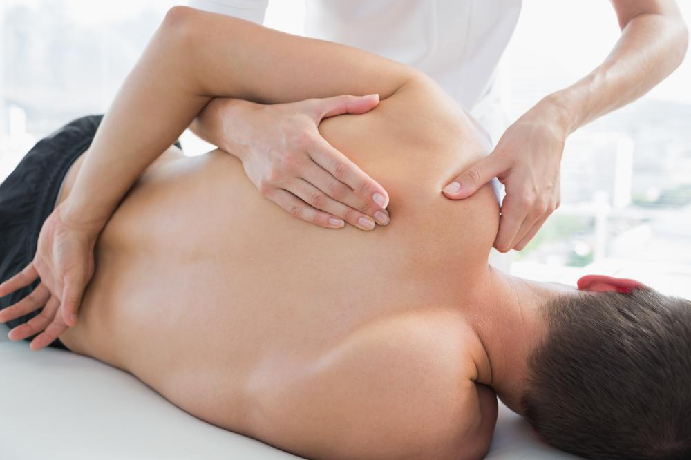 A massage may help treat a stiff shoulder.