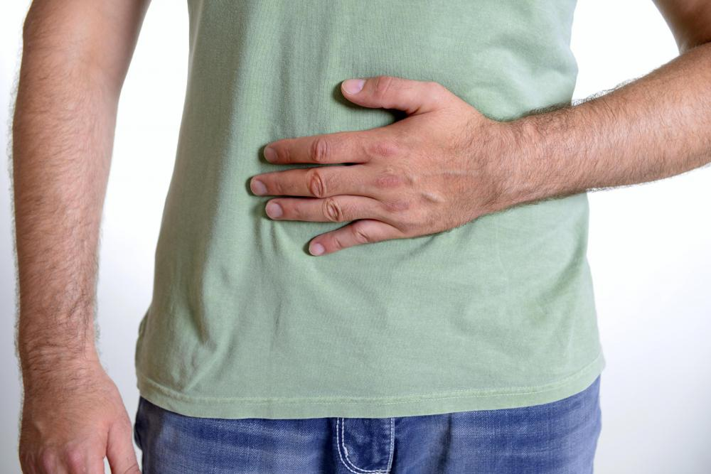 Abdominal pain may be a sign of a colon adhesion.