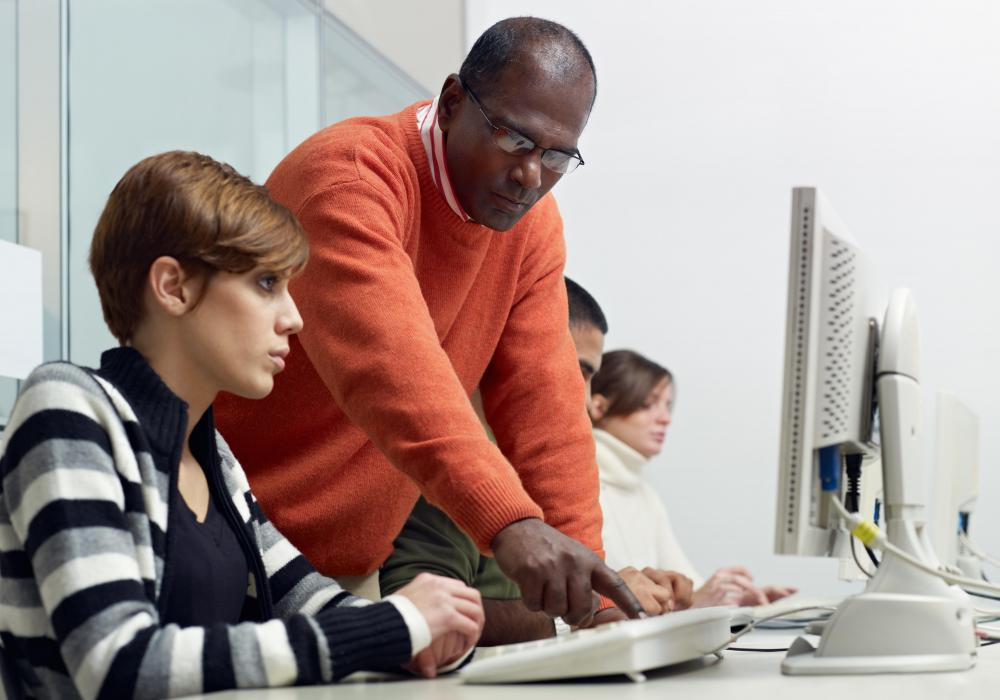 A computer training specialist may teach students or fellow employees to use their computers more efficiently.