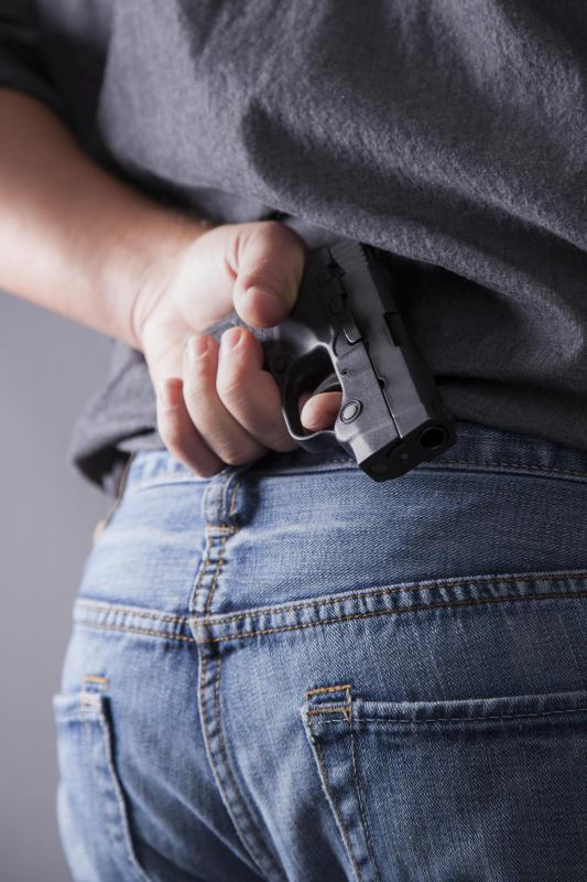 Most gun laws require someone to obtain a permit in order to carry a concealed weapon.