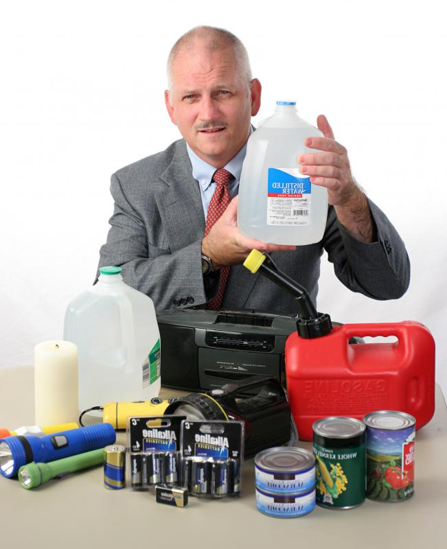Water, batteries, flashlights and extra food should all be included in a disaster kit.