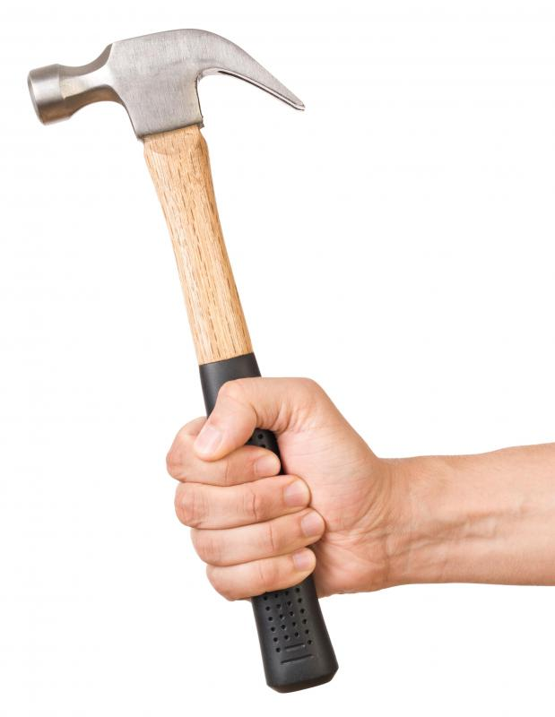 A hammer and chisel may be used for grout removal.