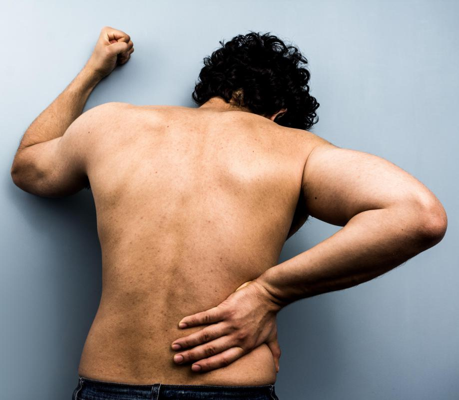 Symptoms of large adrenal cysts may include back pain.