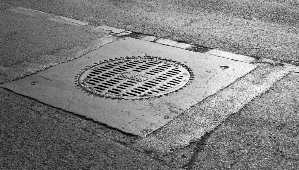 Although heavy, manhole covers can be stolen from city streets.