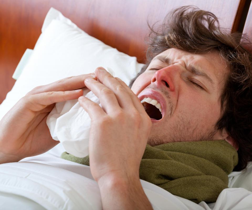 The rubeola virus may be spread through sneezing.