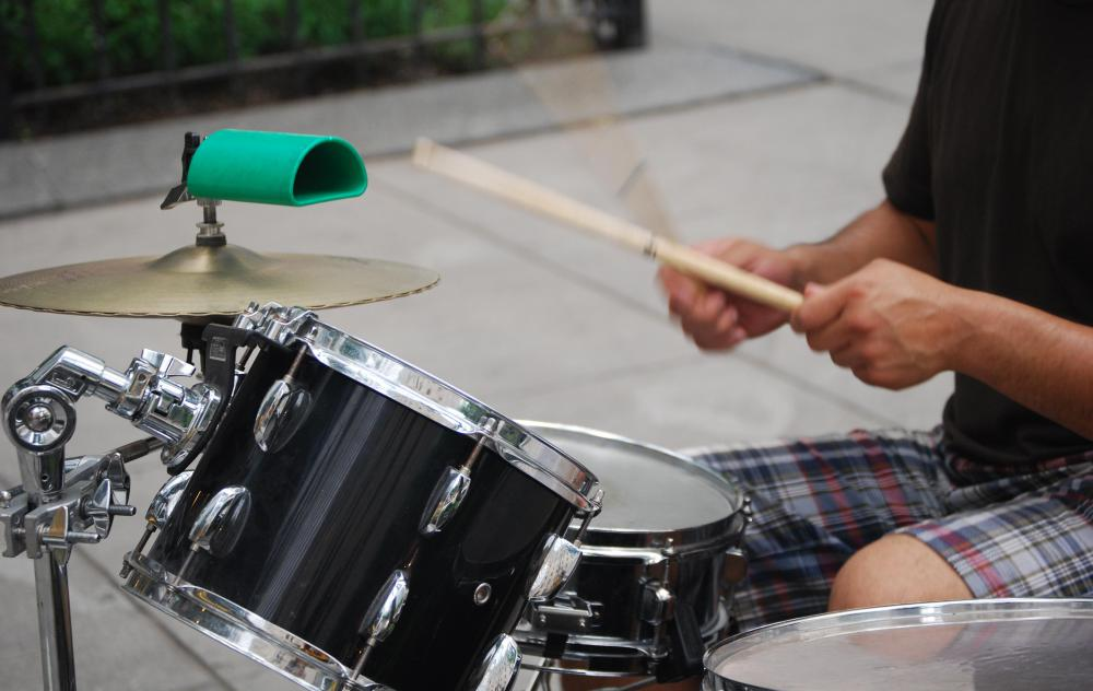 A standard drum kit includes a bass drum, snare drum, hi-hat cymbals, crash cymbals, tom-toms and occasionally a cowbell.
