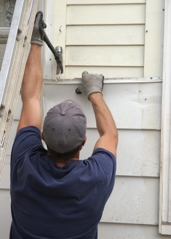 Carpenters may install new siding on a house.