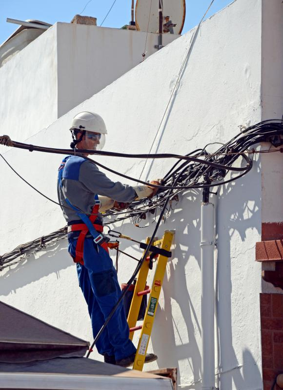 Construction law allows contractors to be fined for OSHA violations, such as improper use of a harness.