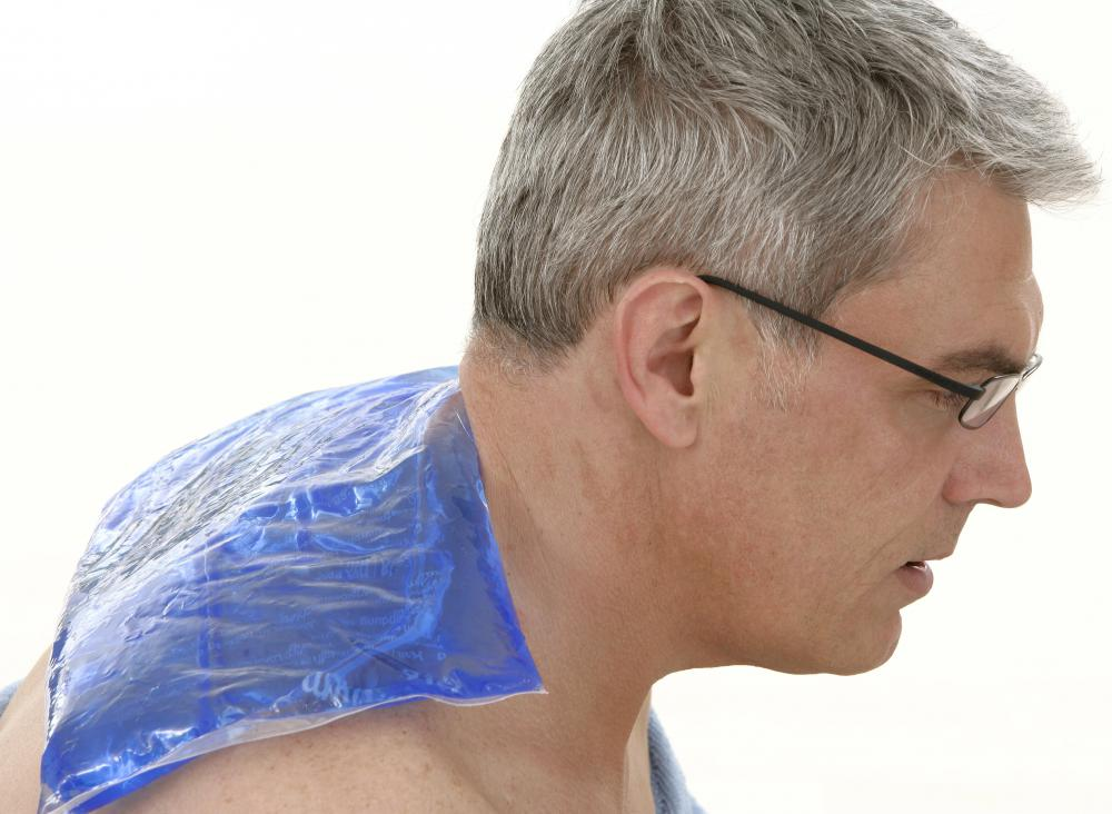 Ice compresses can be used to relieve the pain caused by a muscle spasm in the upper back.
