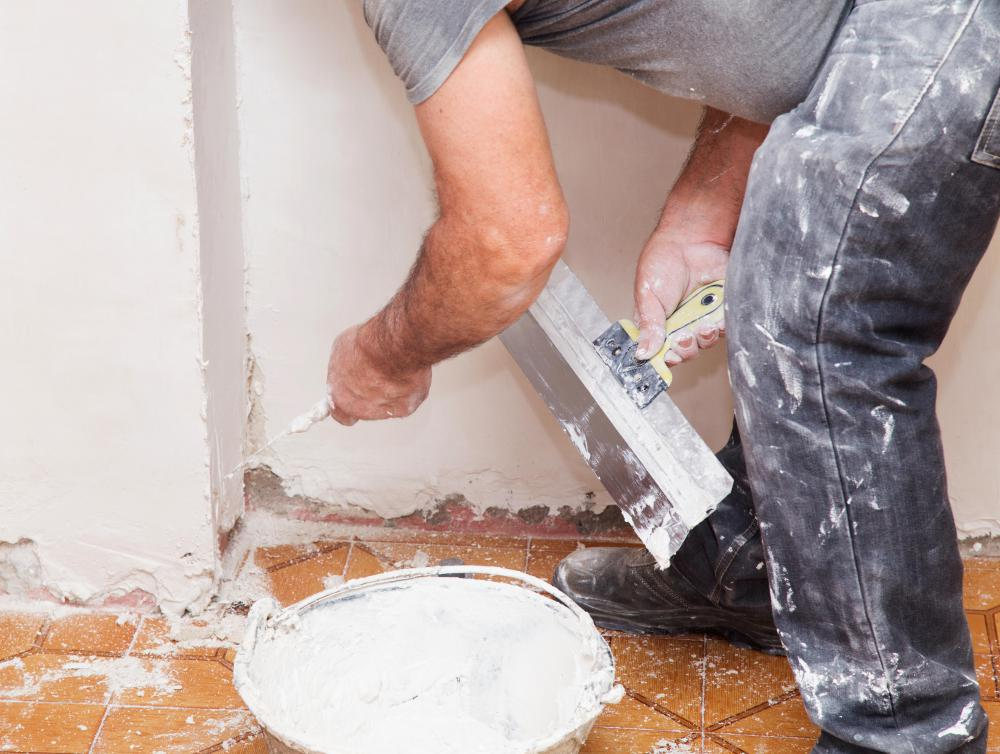 A Plasterer May Apply Plaster On Walls To Manage Repairs Of An Older  Building.