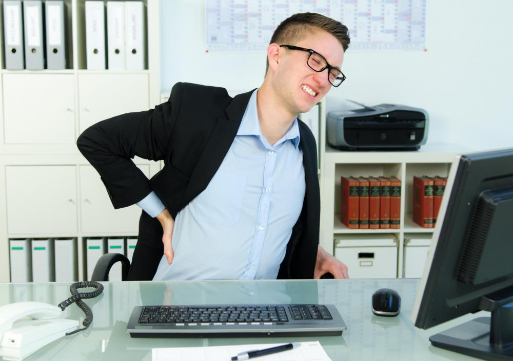 Long Periods Of Sitting At A Desk With Poor Posture Can Cause Back Pain