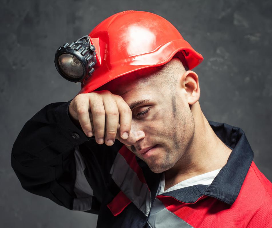Miners usually wear hardhats that are equipped with an electric light.