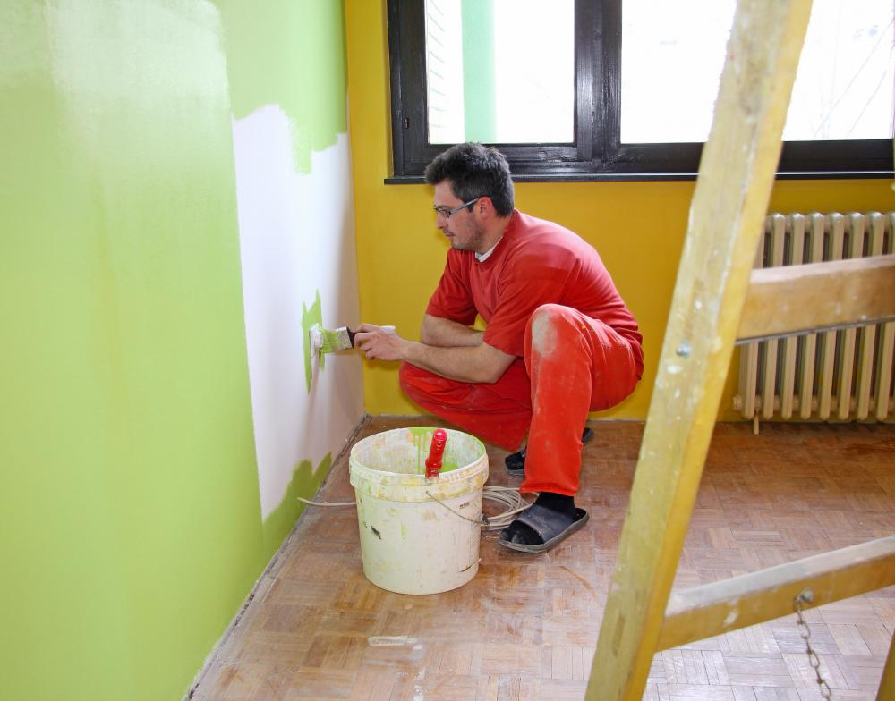 A house-painting contractor will need to measure the area to be painted and determine the kind of paint for the job before giving an estimate. & What does a Paint Contractor do? (with pictures)