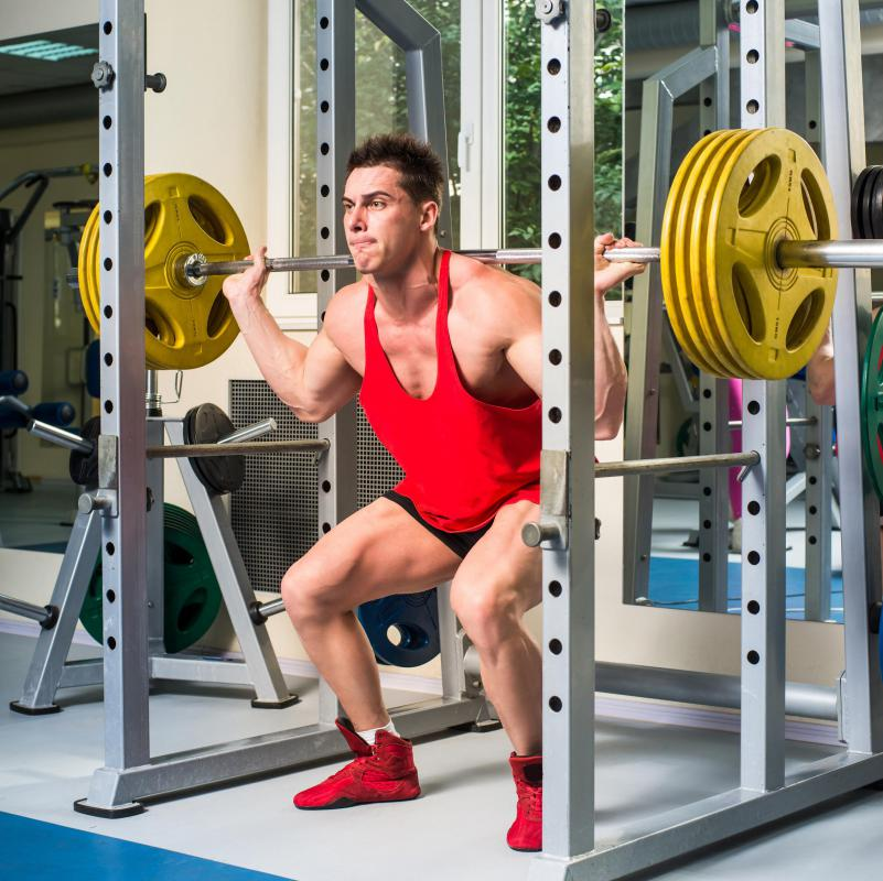 Performing squats, especially with heavy weights, can be performed more safely with the assistance of a power rack or cage.