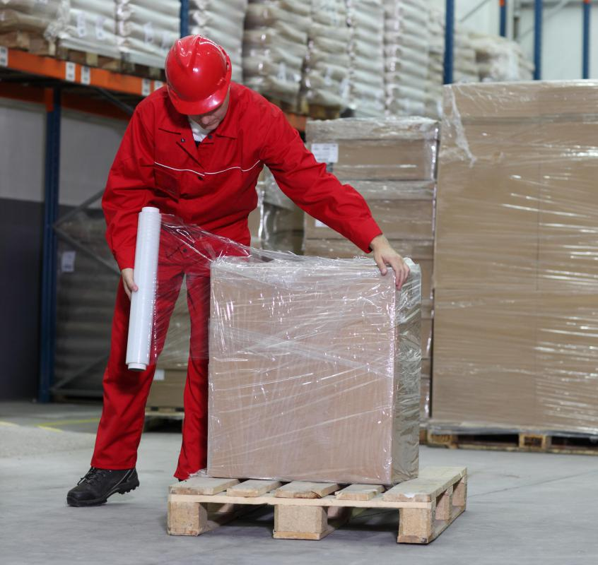 Pallets are often shrink-wrapped to prevent objects from falling out during shipment.