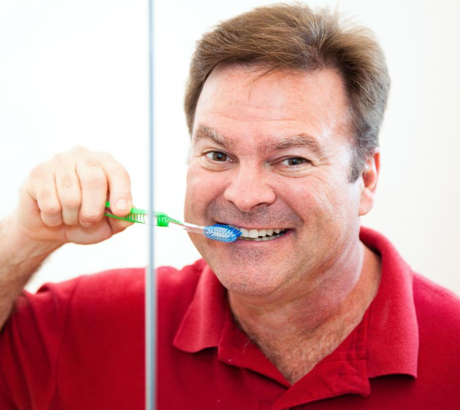 Brushing teeth with hard-bristle toothbrushes can damage gums.