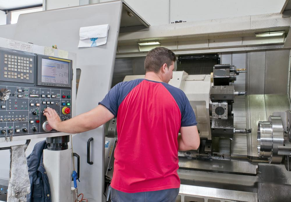 A CNC lathe operator programs the machine to perform the task and monitors the work, making all necessary adjustments.
