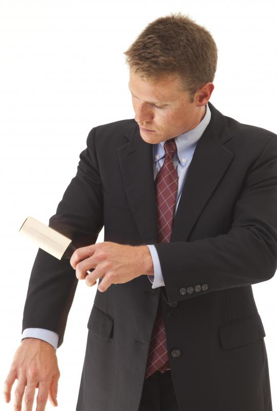 A lint roller can be great for removing unwanted items from an otherwise clean suit.