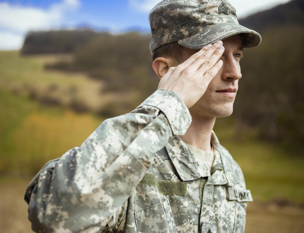 An army recruiter is responsible for gathering people to enlist in the army.