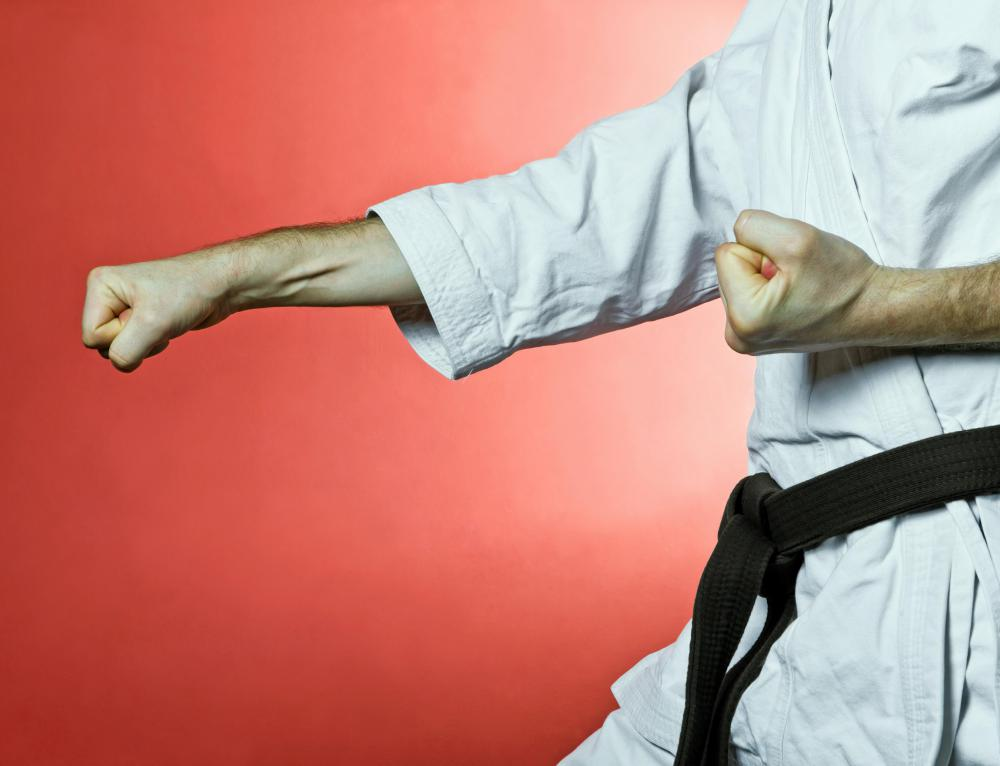 Karate instructors typically hold a black belt in the martial art.