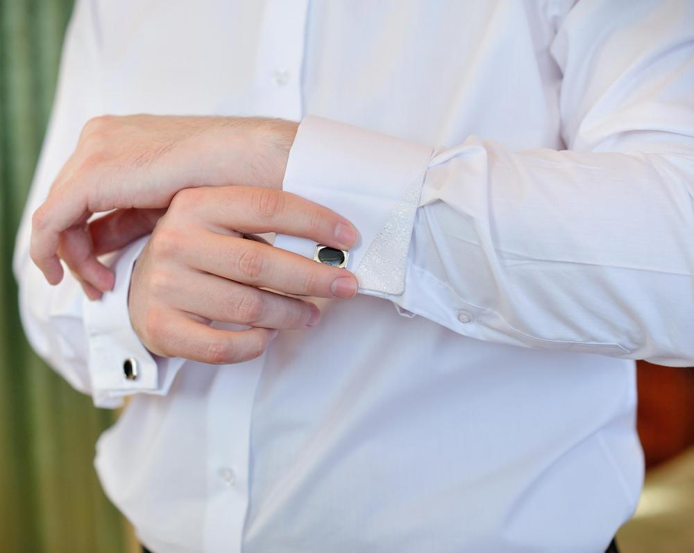 A French cuff is folded over and held in place with a cuff link rather than a button.