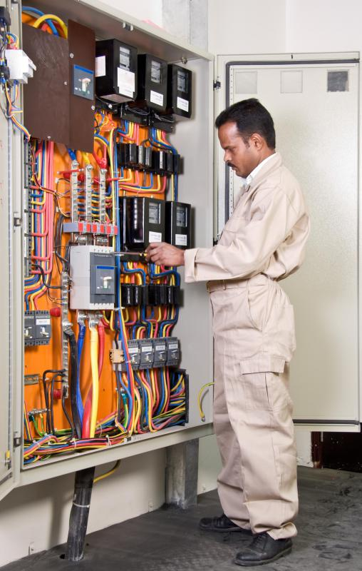 man in white standing at wires and controls what is the difference between a fuse and a circuit breaker? difference between fuse box and circuit breaker at edmiracle.co