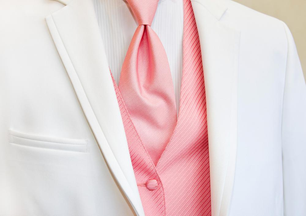 When learning to tie a tie, you should first stand in front of a mirror with your shirt buttoned to the top.