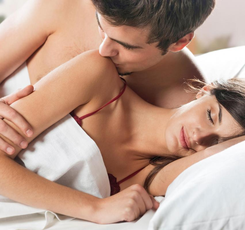 Man and woman making out in bed